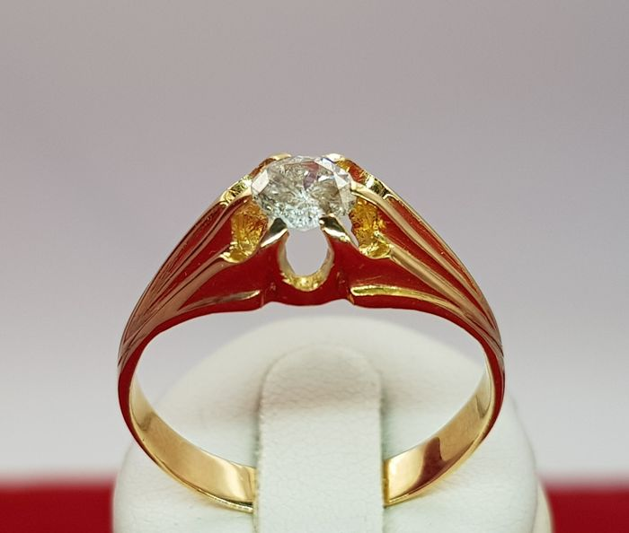 Solitaire ring in yellow gold of 18 kt with a large diamond of 0.50 ct, quality I1 and colour G