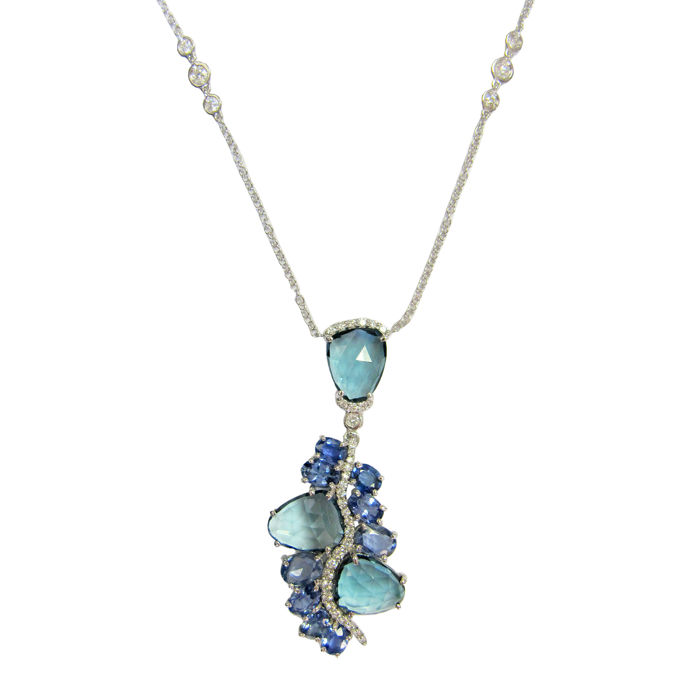 Rose gold necklace with diamonds, blue sapphires and blue topaz