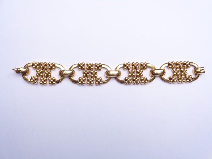 18 kt yellow gold bracelet consisting of 4 motifs with articulated balls.