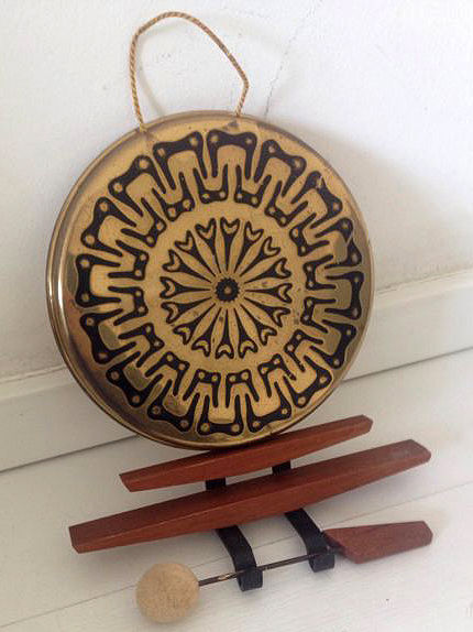 A copper gong with wooden stand. Second half of the 20th century