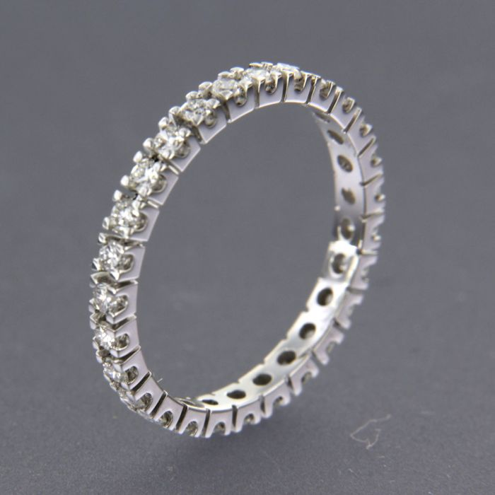 18 kt white gold full eternity ring set with 27 brilliant cut diamonds, approx. 0.56 carat in total