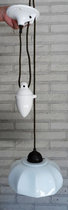 Opal glass pendant lamp with white ceramic counterweight and ceiling plate. 1960s, Netherlands