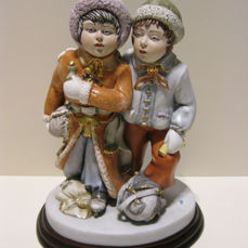 Capodimonte porcelain statue of two ice skaters ( a boy and a girl)