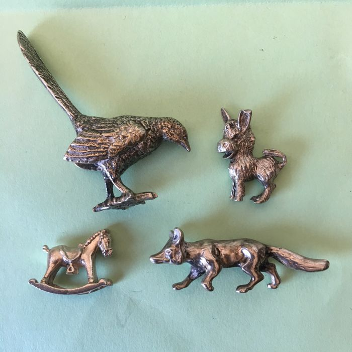4 Silver miniature of animals, rocking horse, donkey, bird, fox