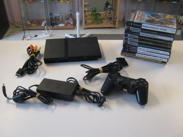 Sony ps2 + memory card + controller with 10 top games like: Kingdom hearts 1&2 + King kong special edition + Spyro + Rayman Trilogie and more