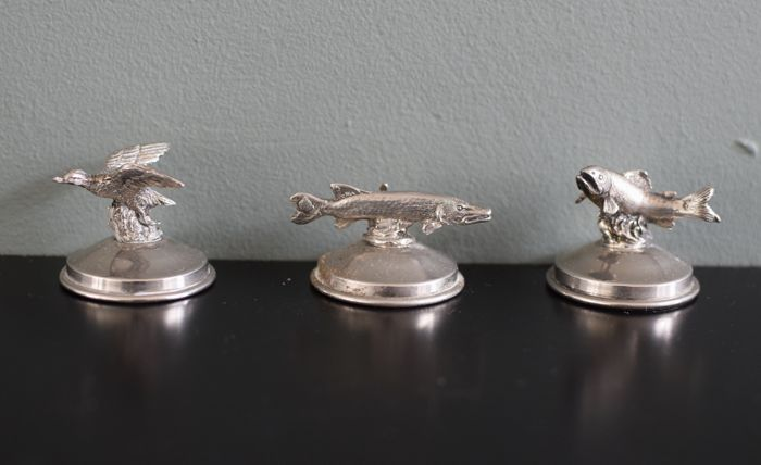 Silver place card holders (menu) of miniature Pike, Trout and a duck