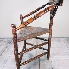Antique oak corner chair with three legs