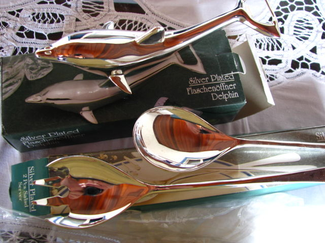 Silver plated dolphin and cutlery