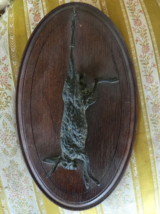 Hare in bronze on oak plaque