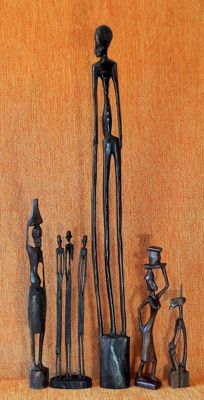 A group of five hand-carved wooden figurines - 20.5 to 72 cm