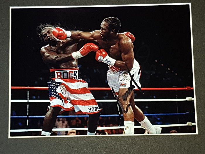 Lennox Lewis - Heavy weight world champion Legend - hand signed framed photo + COA