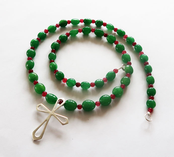 Necklace made of emeralds and rubies, adorned with a large sterling silver cross