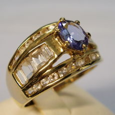 Men's ring with oval faceted natural tanzanite (1 ct) and white topazes in baguette cut (1.50 ct)