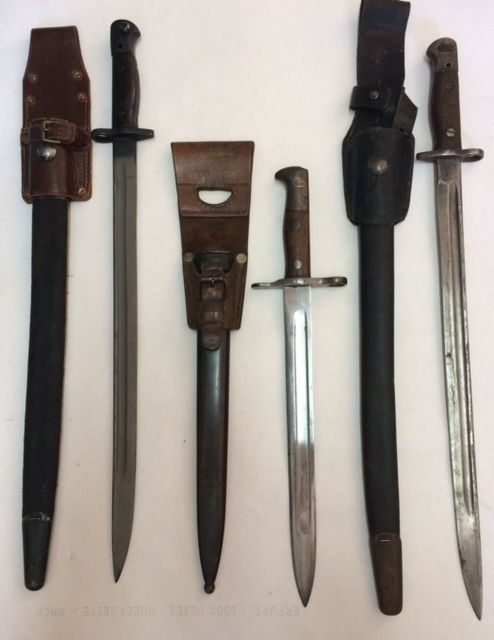 3 International bayonets each with a leather frog from the dissolution of a collection