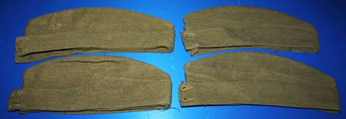 Lot of 4 British world War II Military caps,  marked with broad arrow, dated, no buttons or badges, in fair condition, see photo's