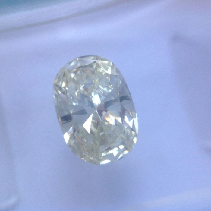1.01 ct Ovaal geslepen natuurlijke diamant U-V, Light Yellow, VS1