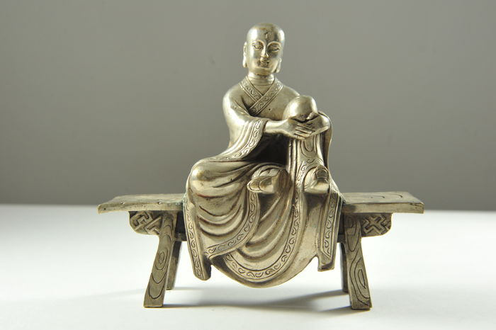 Monk Sitting on a Bench - silver plated Bronze - China - late 20th century