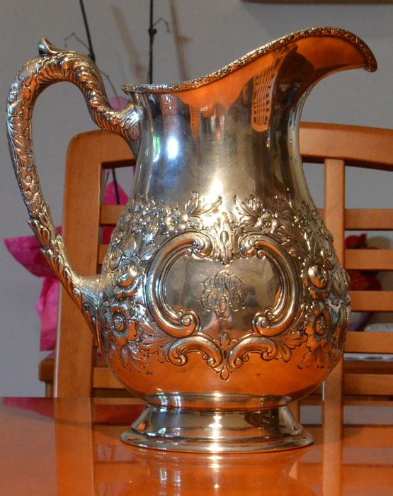 Silver water pitcher, embossed and decorated, realised by Schofield Co., Baltimore - 1903/1905