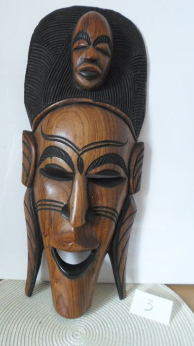 Big and beautiful African mask - Heads on top of each other - Carved in teak wood