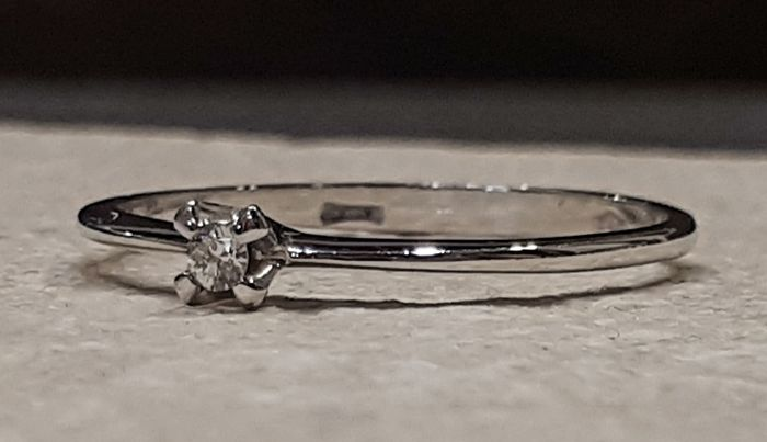 Solitaire ring with 0.03 ct diamond In 18 kt white gold Size 17 mm
