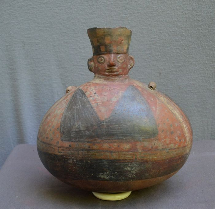 Pre Columbian Huariwari Pottery Vessel With A Ornamental And Face