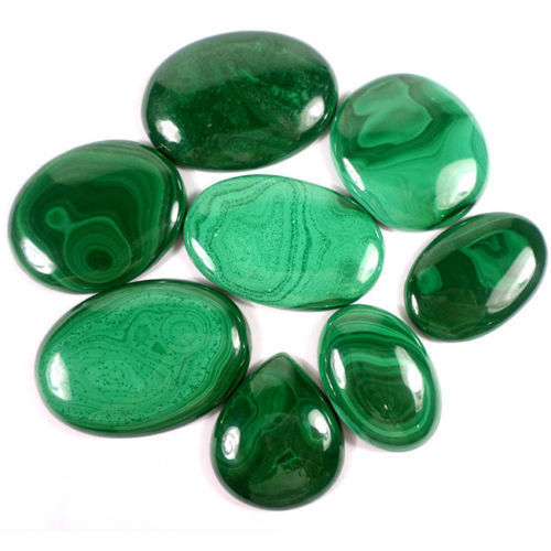 8 pieces of Malachite Cabochons 960.00 ct