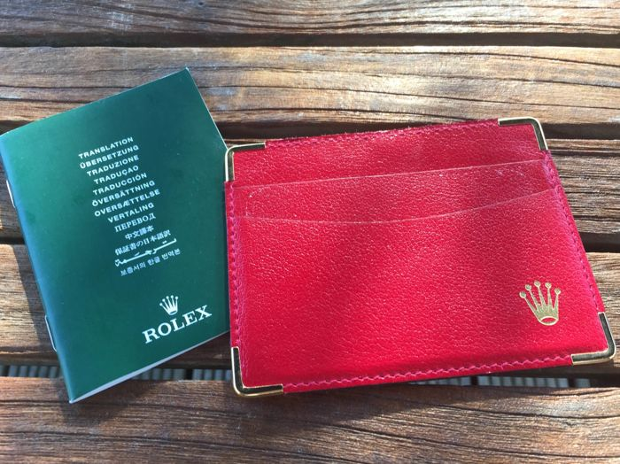 rolex card holder and translation booklet (12 photos)