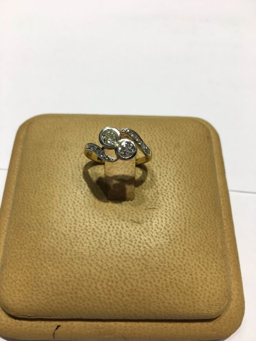 Platinum and gold ring with diamonds