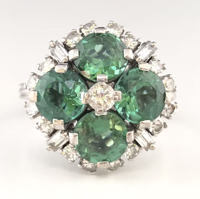 Vintage ring in 18 kt grey gold decorated with 4 tourmalines and brilliant and baguette cut diamonds (4.8 ct)