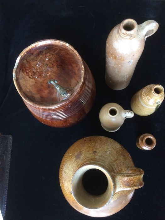 Five stoneware jugs and an earthenware jenever vessel
