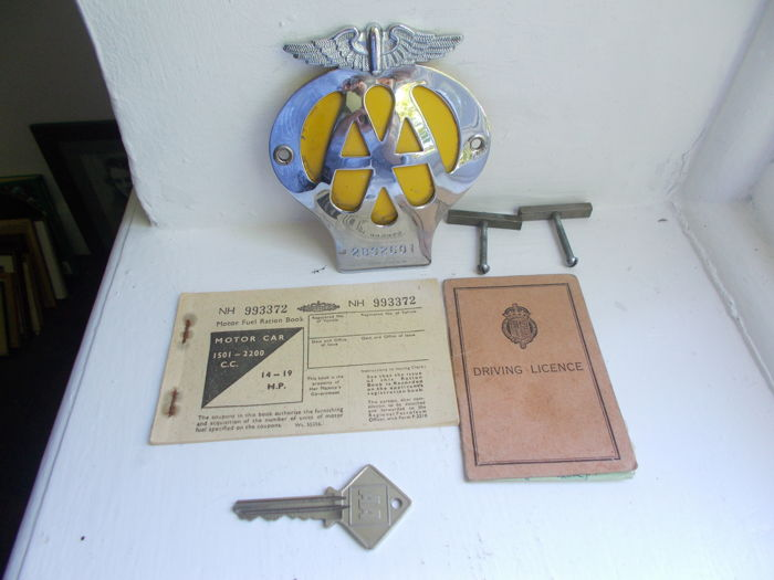 vintage AA chrome on brass car badge with AA phone box  key a driving licence and a fuel  ration book