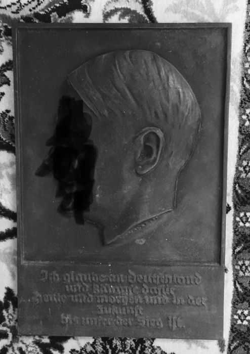 "Wall relief of A.H., signed on the neck  'W. Wolf 33"", M.'"