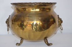 Antique large copper cachepot with lion heads and lion feet