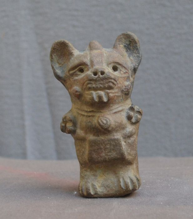 Pre Colombian sculpture/flute, standing figure with face decoration on the chin