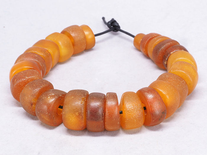 24 Antique natural amber beads. West African trade