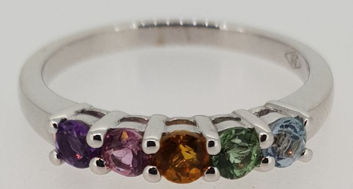 18kt eternity ring set with amethyst, citrine, topaz and tourmaline. Ringsize: 54