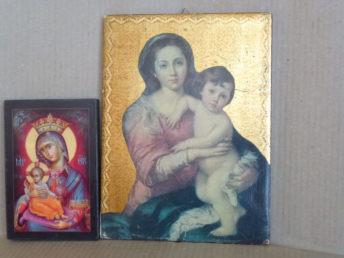 Two wooden boards with images of Mary and Child - A Byzantine style icon from Romania and a reproduction of a famous 1650 painting by Bartolomé Esteban Murillo exposed at Palazzo Pitti in Florence.