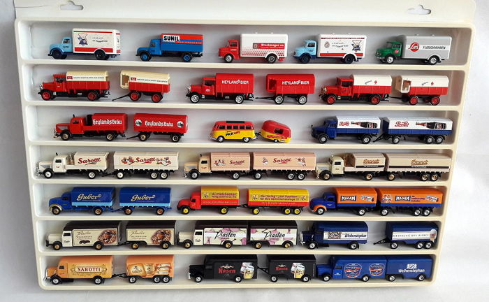 Lot with 41 pieces of nostalgic advertising trucks and trailers old advertising, scale 1/87 in the collection box