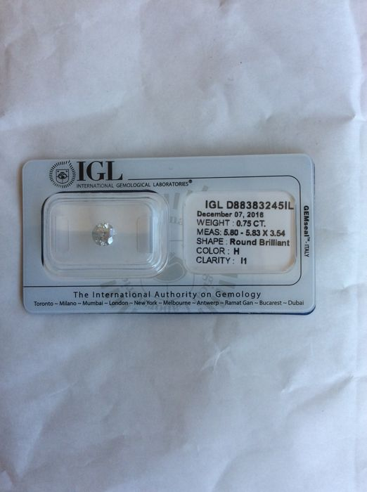 Round brilliant cut bulk diamond of 0.75 ct, colour H, I1, with IGL certificate stamp *no reserve*