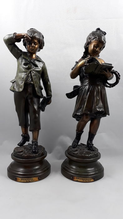 After August Moreau - 'Recompense' / 'Punitition' - Girl standing and reading a book / Boy weeping - Patinated bronze sculpture set - France - 20th century