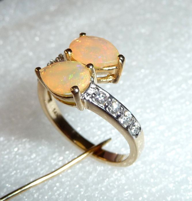 585/14 kt gold ring, 2 Ethiopian opal drops approx. 4 ct + approx. 0.40 ct diamonds, ring size 54 - adjustable