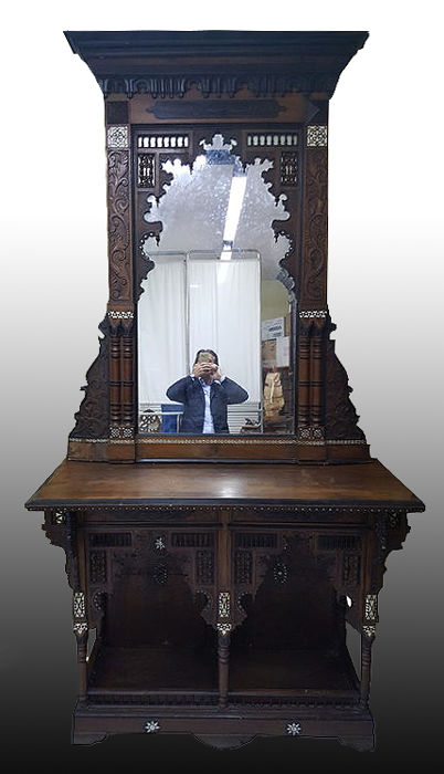 Atributed to Joseph Parvis (1831-1909). An Egyptian rosewood, bone and mother of pearl inlaid ebonized console and mirror, second half 19th century