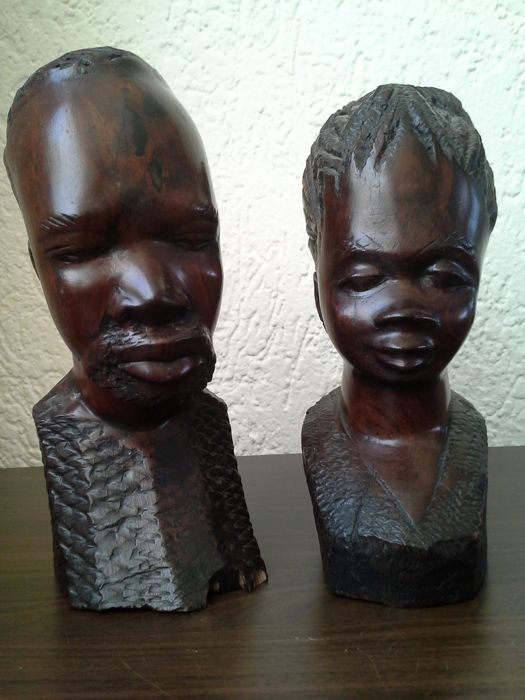 Two full African busts of a man and a woman in Ebony wood