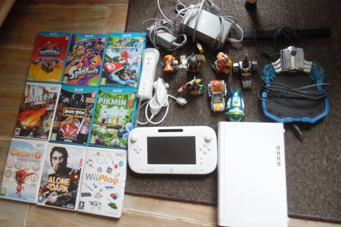Wii U 32 GB including 9 games. Like Mario Kart 8 + Pikmin + Spaltoon + Angry Birds and more