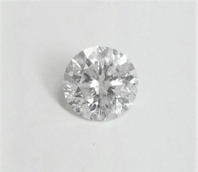 Round Brilliant Cut  - 1.31 carat - F color - SI1 clarity - 3 x EX - Comes With AIG Certificate + Laser Inscription On Girdle
