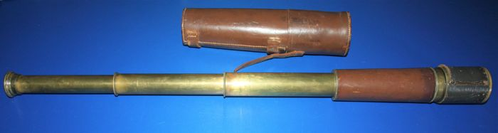 A WW 1 British brass three draw telescope with military mark and Tel.Sct.Regts mkIIs, 2961 O.S.126.GA stamped to first draw with B.C Ltd & Co maker's mark, in original leather case