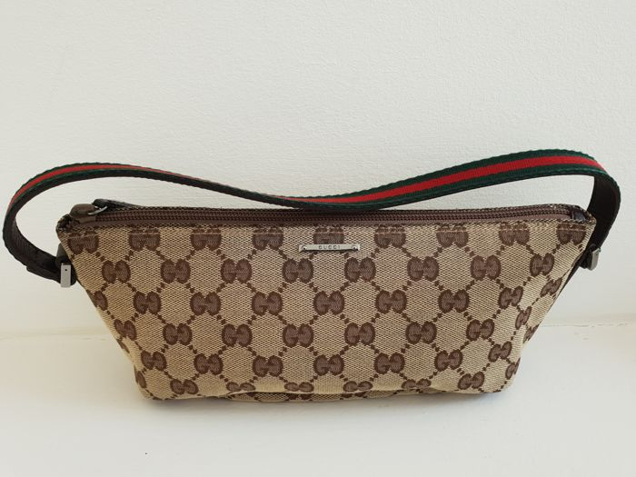 63048522e0ad Gucci - GG canvas pochette Handbag - Catawiki