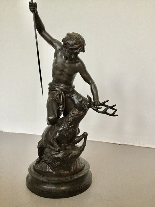 Sylvain Kinsburger (1855-1935) - a zamac/regule sculpture group depicting a hunting scene of a man with a spear and a deer - France - ca 1900