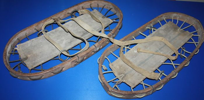 A pair of original world war II British snowshoes, in canvas bag, both dated 1944, in fair to good condition