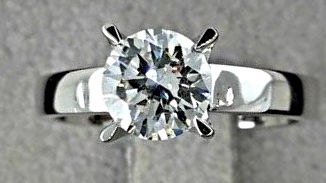 0.98 ct D/VS2 round diamond ring 18 kt gold - size 7,5